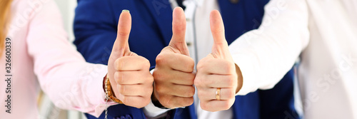 Fototapeta Group of people show OK or approval with thumb up during conference closeup. High level quality product, serious offer, excellent education, mediation solution, creative advisor participation concept obraz