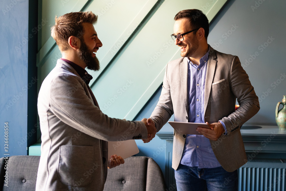 Fototapeta Business handshake and business people concept. Partnership, deal, agreement.