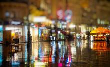 Pedestrians Walking On Rainy N...