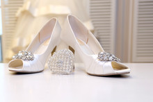 Wedding, White Dress And White Women's Shoes. Women's Jewelry, Silver And Diamonds. Wedding Fashion And Decor