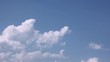 Time lapse fluffy white clouds blue clean sunny sky.