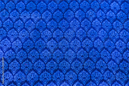The image of the blue Thai silk pattern that is woven in Thailand.