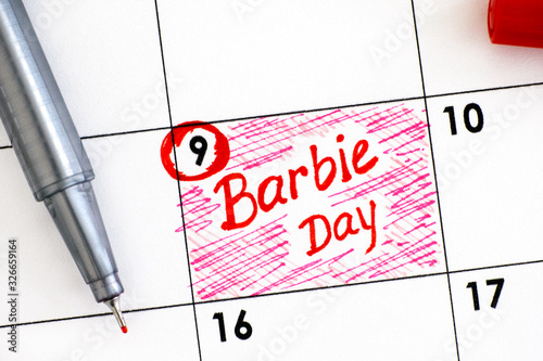 Photo Reminder Barbie Day in calendar with red pen.