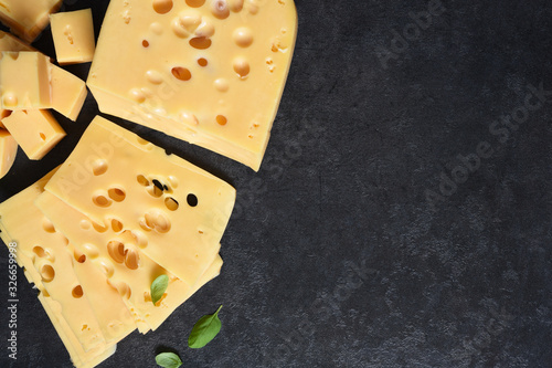 Fototapeta Radamer cheese on a black concrete background. View from above. obraz