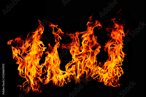 Photo Fire flame isolated on black isolated background - Beautiful yellow, orange and red and red blaze fire flame texture style
