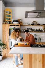 Couple Having Breakfast In Kit...