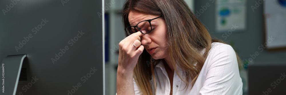 Fototapeta Tired employee in company office
