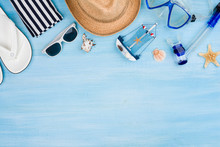 Summer Vacation Concept With Beach Items On Blue Wooden Background