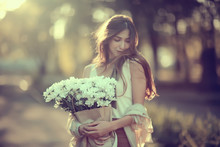 Happy Girl With Flowers In The...