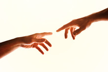Two Hands With Fingers That Almost Touch Isolated White