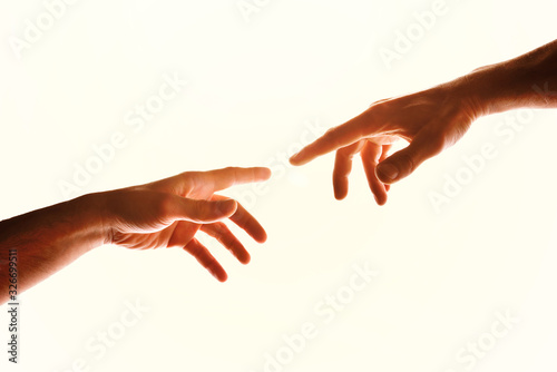 Fotografía Two hands with fingers that almost touch isolated white