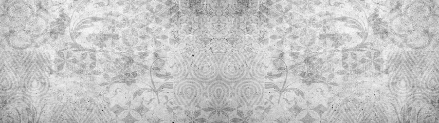 Old gray vintage shabby damask patchwork tiles stone concrete cement wall texture background banner