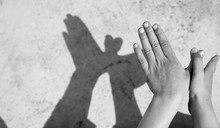 Child Hands Miming A Bird's Wings