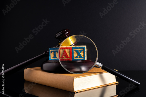 Gavel hammer and book with low light view. Educational concept. Wallpaper Mural