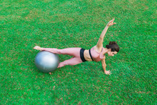 Sporty Young Woman Doing Stret...