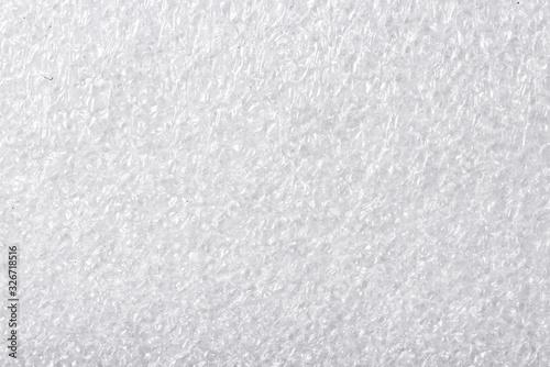 White, textured foam background texture, close up Canvas Print
