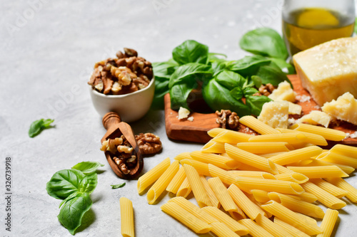 Italy food ingredients  pasta with pesto :   penne  pasta, fresh basil, nuts, parmesan cheese and olive oil Wallpaper Mural