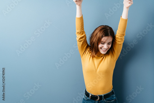 Fotografie, Obraz Happy young woman stretching her arms smiling