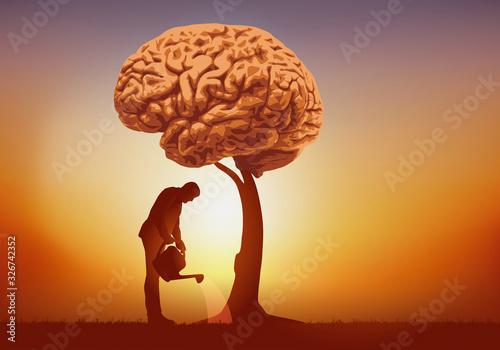 Photo Concept de l'intelligence et de la culture du savoir avec un homme qui arrose un arbre dont le feuillage est symboliquement remplacé par un cerveau