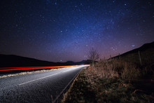 Car Lights Beneath The Starry ...