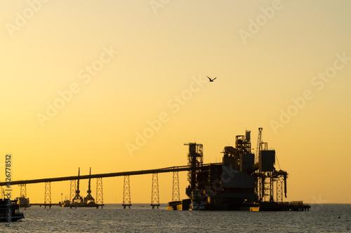 Silhouette of port terminal at sunset in Santarem, Para, Brazil Fototapet