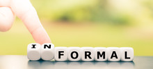 """Hand Turns A Dice And Changes The Word """"formal"""" To """"informal""""."""