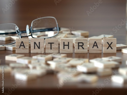 anthrax concept represented by wooden letter tiles on a wooden table with glasse Wallpaper Mural