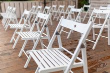 Rows Of White Chairs In Rows O...