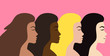 Vector flat cartoon four different nationality women head profiles isolated on pink background. Woman power illustration