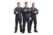 Three mechanic workers in uniforms