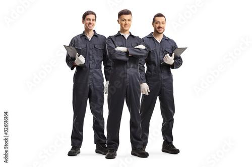 Fotografia Three mechanic workers in uniforms