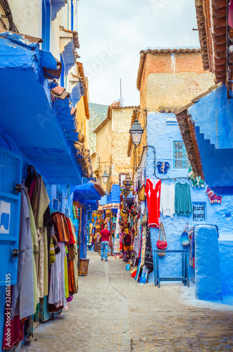 Street market in blue medina of city Chefchaouen,  Morocco, Africa Canvas Print