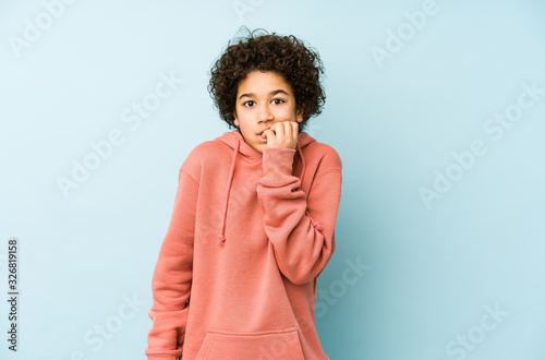 African american little boy isolated biting fingernails, nervous and very anxious Canvas Print