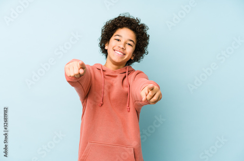 Obraz African american little boy isolated cheerful smiles pointing to front. - fototapety do salonu