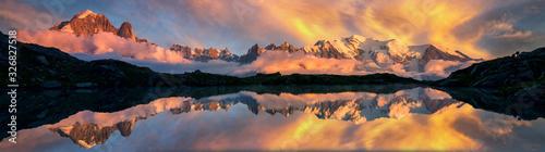 Fototapeta Mountains reflected on a lake in the French Alps, Chamonix at sunrise obraz na płótnie
