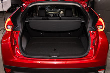 Rear View Of A Red Car With An Open Trunk. Exterior Of A Modern Car .