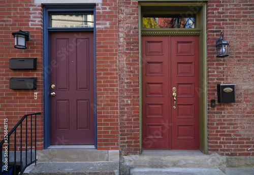 Colorful front doors of adjacent brick row houses Canvas Print