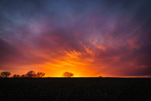 Fiery Sunset Over A Silhouette...