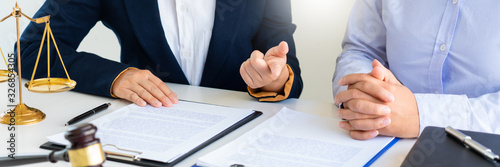 Female Lawyer explaining legal situation and discussing with contract papers, Co Fototapet