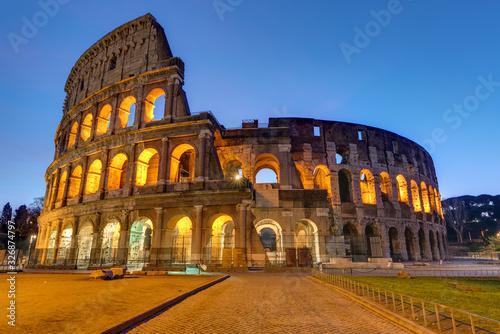 Valokuvatapetti The famous Colosseum in Rome illuminated at twilight