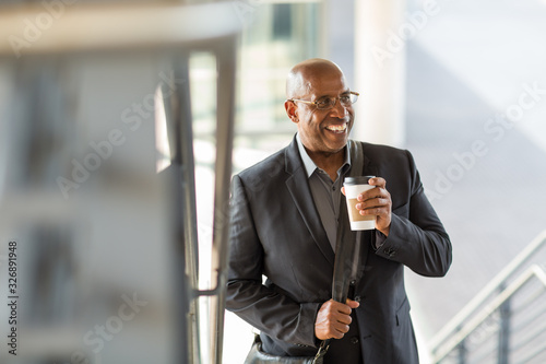 African American businessman drinking coffee on his way to work.