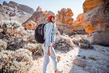 Young Female Traveler Walking ...