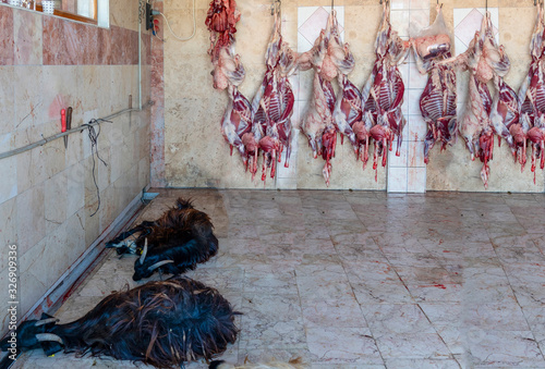Slaughter house with appliance and slaughtering goat animal. Wallpaper Mural