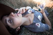 Girl Lies In Dry Grass