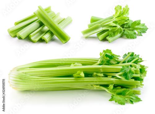 Obraz Celery stalk isolated. Celery sticks on white. Green celery with leaves. Set on white background. - fototapety do salonu