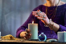 Fortune Teller Woman Using Burning Candle Flame For Witchcraft, Divination And Fortune Telling. Spiritual Esoteric Paranormal Magic Ritual Illustration