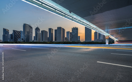 cityscape and skyline of shanghai from empty asphalt road. Wallpaper Mural