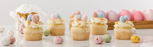 Delicious Cupcakes With Colorful Painted Chicken And Quail Eggs Near Easter Cake On Grey Background, Panoramic Shot