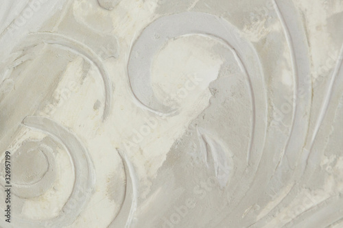 background and texture of a bas-relief pattern on a concrete wall Canvas Print