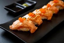Grilled Salmon Sushi On Black ...